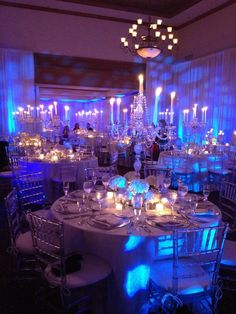 Table creation by Vivian Colls. Gorgeous blue reception lighting ideas  Becky- thought this was neat how they turned the reception blue with lighting instead of having blue items.