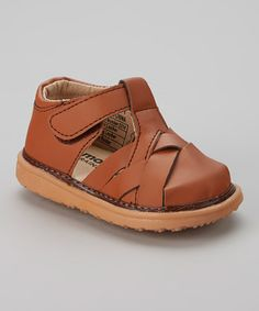 Brown sandals for boys can be paired with a church outfit or more casual for the playground!  toesandts.com