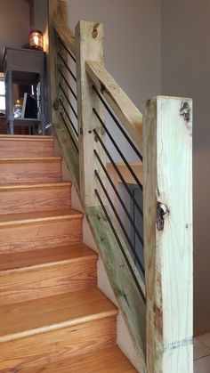 Rustic staircase railing made from 4x6's and rebar