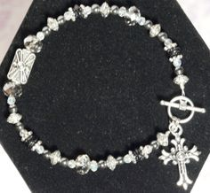 7.5 Crystal and Metal Beaded Bracelet with Silver Tone Cross Dangle in Clear and Mercury Crystals with Silver Tone Toggle Clasp