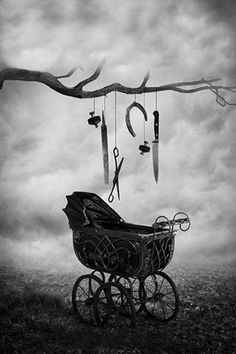 Gothic baby carriage  Look only at the carriage....