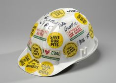 WOMEN AGAINST PIT CLOSURES' HELMET, 1984-1985 From the Miners' Strike, this helmet is a strong visual reminder of one of the most troubled times in Barnsley's modern history. Experience Barnsley Museum collection.