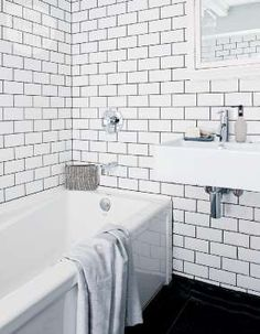 Maude loves the downstairs bathroom's floor-to-ceiling subway tile with contrasting grout. - Style at Home