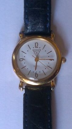 Guess Vintage 1991 Gold Tone Navy Blue Leather Strap. Great Gift! $14.58 #VintageGuess #GuessWatches #Watches #FreeShipping #GiftIdeas #Vintage #ChristmasSale Item has sold.