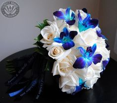 White Roses and Blue Orchids In case anyone was wondering.... These are my wedding colors. I think they are pretty.