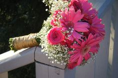 Country style pink floral bouquet with Roses and Gerber Daisies. weddingflowersbycyndi.com