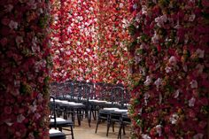 floor to ceiling flowered walls decor of christian dior fw