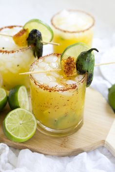 Spicy Jalapeño Mango Margaritas are a delicious sweet and spicy drink perfect for hot summer days outdoor grilling taco Tuesday or Cinco de Mayo parties! Jalapeno Margarita, Mango Margarita, Margarita Recipes, Spicy Margarita Recipe, Watermelon Mojito, Summer Cocktails, Cocktail Drinks, Fun Drinks, Yummy Drinks