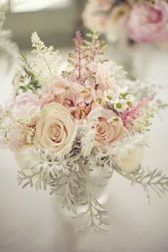 """Vintage Pastel Centerpiece...also love the use of the white """"greenery"""" that is peaking out beneath the roses. This would be a great leaf to add to any beachy bouquet. It reminds me of something you'd find under the sea!"""