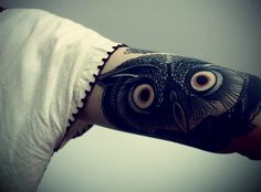 Owl tattoo, upper arm.    original source unknown, tattoo artist unknown