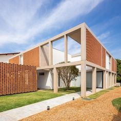 Brick screens are set into framework of concrete columns and beams at Casa Grid