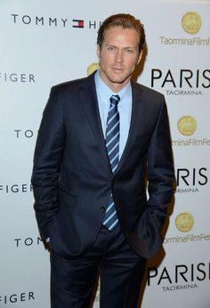 Actor Jason Lewis looked dashing in a navy two-button suit from the Tommy Hilfiger Tailoring collection with a pale blue button-down, a blue, green and white striped silk tie, and black leather oxfords, by Tommy Hilfiger