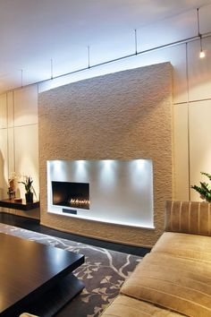 Playing with placement, shelving and lighting can make an otherwise standard fireplace the focal point of any room