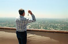 President Ronald Reagan throwing paper airplanes (made from official White House stationary) off a hotel balcony in L.A. :)