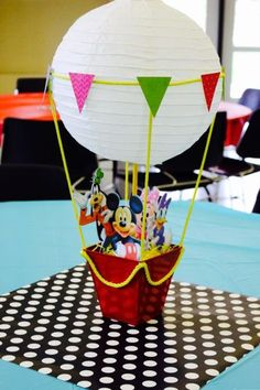 Up, up, and away with this hot air centerpiece.  See more Mickey Mouse birthday party and kids birthday party ideas at www.one-stop-party-ideas.com