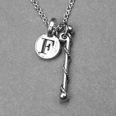 Baton necklace, baton charm, cheerleader necklace, majorette baton charm, baton twirling charm, personalized necklace, initial charm, letter by chrysdesignsjewelry on Etsy
