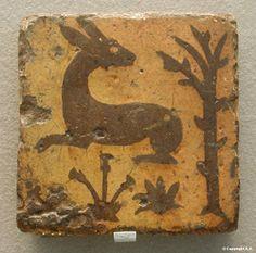 Rabbit -   XIVth century, Glazed clay  - Louvre Museum
