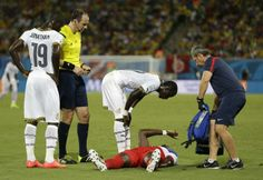 FIFA World Cup 2014, Match 13: Ghana vs USA United States' Jozy Altidore gestures as he lies on the pitch after pulling up injured, as referee Jonas Eriksson of Sweden, looks on as a United States team trainer arrives to help during the group G World Cup soccer match between Ghana and the United States at the Arena das Dunas in Natal, Brazil, Monday, June 16, 2014. (AP Photo/Ricardo Mazalan)