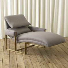 Lounge Chair with a Brass Base