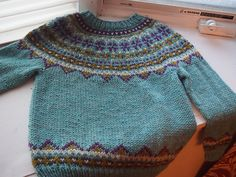 """Ravelry: Project Gallery for """"Fimma"""" Lopapeysa (Icelandic lopi wool Fair Isle sweater) pattern by Sarah Dearne"""