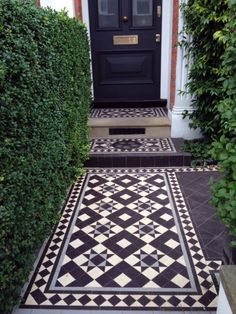 Curb Appeal: Black-and-White Mosaic Tile from London with Love Victorian Mosaic tile path London Curb Appeal ; Gardenista The post Curb Appeal: Black-and-White Mosaic Tile from London with Love appeared first on Outdoor Ideas. Victorian Front Garden, Victorian Mosaic Tile, House With Porch, Victorian Front Doors, Victorian Terrace, Porch Tile, Front Garden, Patio Flooring, White Mosaic Tiles