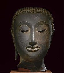 A bronze face mask of a Buddha Thailand, Ayutthaya, 15th century The oval face with a serene expression, crisply and sensitively delineated lips, straight nose joining arched brows, the heavy-lidded eyes cast downward, framed by delicately curved eyebrows echoed by the hairline, the separately cast back of the head now missing 11¼ in. (29 cm.) high
