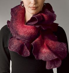 Bordeaux Rose Scarf by Jenne Giles. Crafting her scarves using the most ancient of fabric techniques, the artist crafts this sumptuous felted scarf from Merino wool, tussah silk, and silk chiffon for a scarf that's as pleasing to the skin as it is to the eye. Each piece is unique. Color and dimensions will vary slightly. Hand Wash