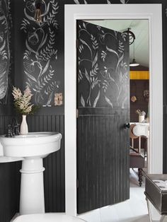 Chalkboard paint from Benjamin Moore yields a changeable canvas in this powder room.