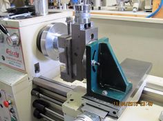 Lathe Milling Attachment by turntable -- Hi guys; Here is my homemade lathe milling attachment. made out of .750 mild steel plate. It doesn't get used to often, the main use of it is for cutting the ejector groove in rifle barrels. that reminds me I should post a couple rifles I have...