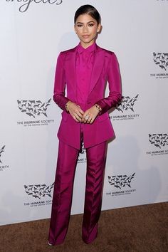 Zendaya in a buttoned-up pink suit. Awesome.pro