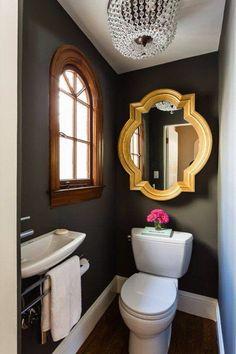 Simple dark powder room, feature framed mirror