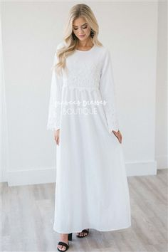 e7af805f5f86 This white dress features lace detail across the bodice