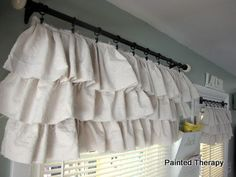 Painted Therapy: DIY Ruffled Curtains tutorial. This would be cute where you have blinds already