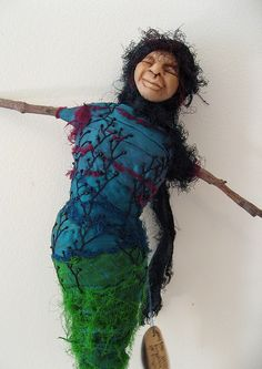 Art doll by Wilma Simmons  - Message stick - wrapped stick armature ( sari ribbon and bead embroidery), polymer clay head, handwritten message on hand made wooden tag ( When everything is unsure, anything is possible. Margaret Drabble)