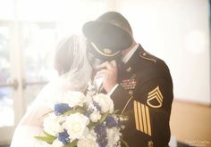 military groom, military hat, bouquet, long veil, military wedding