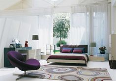 Achieving Best Interior Design Inspiration: Fascinating Interior Design Inspirations For Master Bedroom Ideas With Sectional Purple Sofas Floating Bed Design And Re Coverlet Brown Headboard White Luxury Curtains For Window Dressing ~ surrealcoding.com Interior Inspiration
