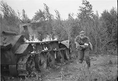 Finnish soldiers running past a burning tank BT-7. Pin by Paolo Marzioli