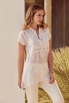 Our Britta Tonal Tunic blouse is delicate and refined. This light and subtly transparent tunic is decorated with intricate floral patterns, accented by delicate cut-outs along the shoulders. Effortlessly elegant, this tunic works beautifully with jeans or as a cover-up after a day at the beach.
