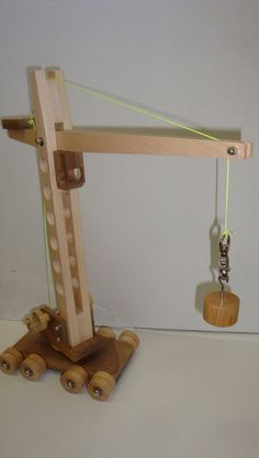 Toy crane based on plans in old Wood magazine. Woodworking For Kids, Woodworking Toys, Toy Crane, Wooden Toy Trucks, Making Wooden Toys, Wooden Pattern, Wood Games, Kids Wood, Wood Toys
