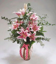 Matlack Design - STARGAZER:  A simple & elegant arrangement of Stargazer Lilies in a subtly tinted pink vase.  Price Range:  $74.95 / $84.95 / $94.95  #MatlackFlorist