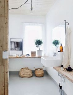 wood and white in the master bedroom like this - with plants and baskets to add pops