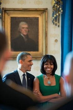 Michelle, a-mazing. They're almost synonymous. The First Lady's style may go down in history as BC or AC, Before Cut or After Cut. She looks incredible in this green dress with square neckline and huge drop pendant necklace. From the looks of it, President Barack couldn't be happier with her.