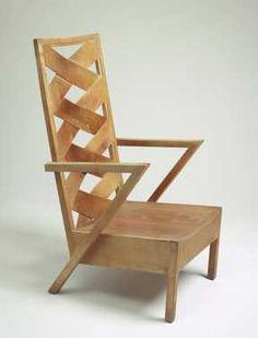 Stoel met hoge rug (1942)  Gerard A. van de Groenekan (uitvoerder), Gerrit Thomas Rietveld (ontwerper). Iepenhout, beukentriplex.