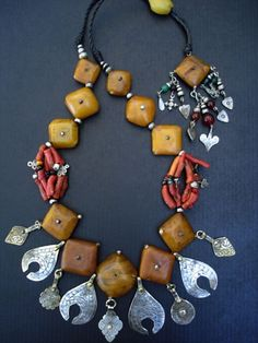 Designed by Faouzi | Coral, Moroccan silver and 'Amber' beads from the African Trade period