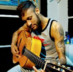 Neymar playing guitar