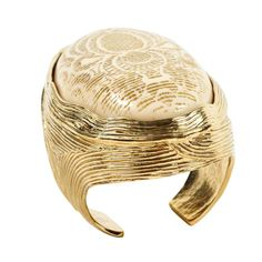 Unique and Impressive Cuff by Yves Saint Laurent    From a unique collection of vintage Cuff Bracelets at https://www.1stdibs.com/jewelry/bracelets/cuff-bracelets/.