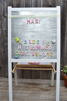 paper{whites}: ikea MALA easel Hack- they painted the frame white, and added a sheet of steel to the whiteboard side for magnets