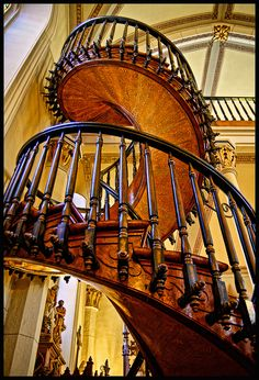 The Loretto Chapel Staircase,  also called the Miracle Staircase.  Entirely self-supporting, no central column, and wooden pegs rather than nails.  Built by an unknown carpenter who built it, then disappeared without pay.