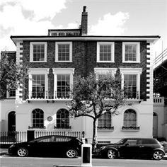 Semi detached period townhouse restoration. Grade II listed. Half stucco. Brick quoins.