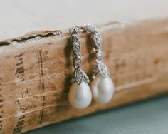 Add a delicate touch of vintage to your wedding day look and beyond. Swarovski crystal encrusted earring fittings with a teardrop ivory freshwater pearl. Pearl Earrings Wedding, Pearl Drop Earrings, Pendant Earrings, Bridal Earrings, Wedding Jewelry, Wedding Hair, Lace Wedding, Wedding Dresses, Wedding Accessories